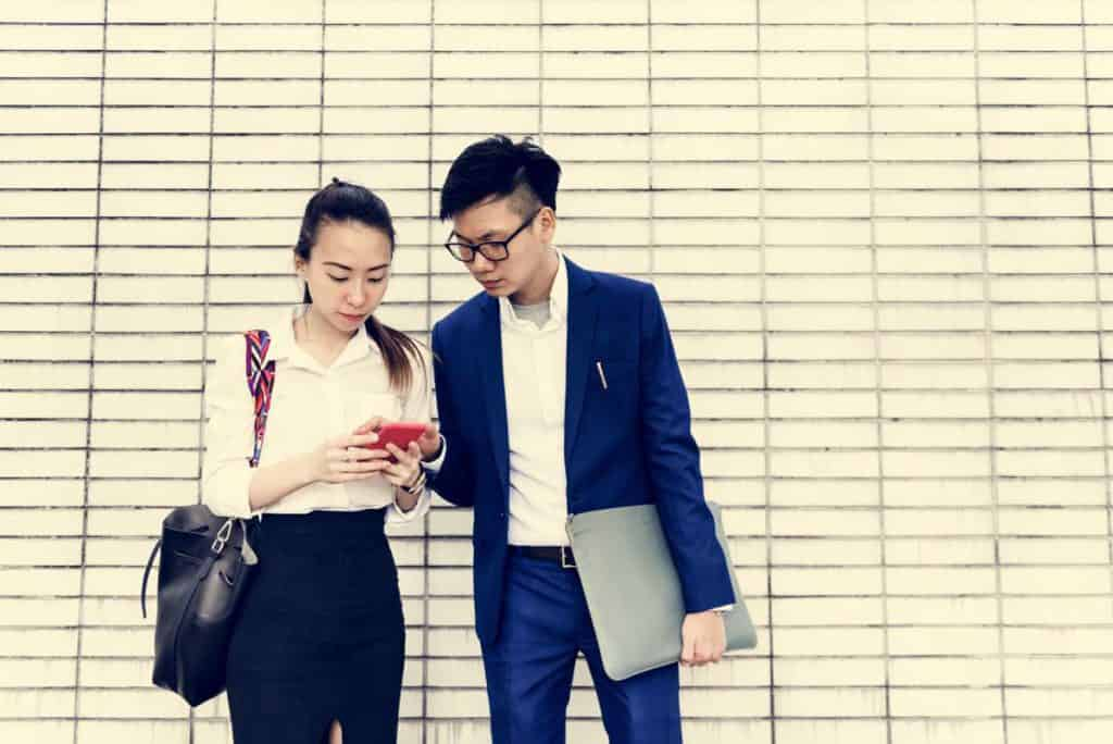 Young Singapore Couple Calculating HDB Downpayment